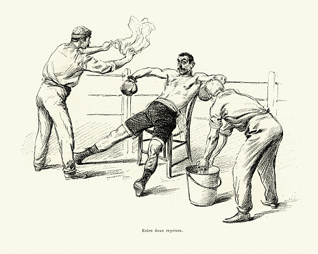 Vintage engraving of a contest between the english boxer Jerry Driscoll and the french Savate figher Charles Charlemont. Charlemont resting between rounds. L'Illustration, 1899