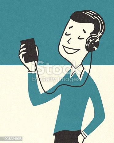 istock Boy Listening to Music 1003224956