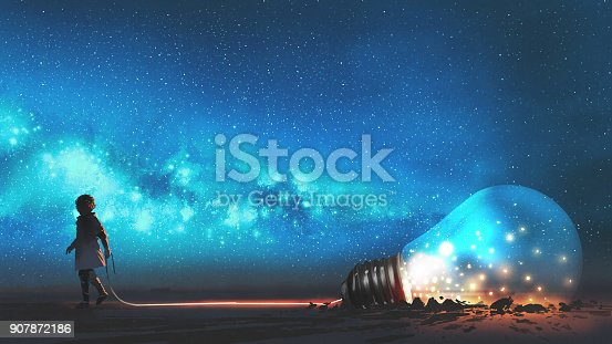istock boy pulled the bulb buried in the ground 907872186