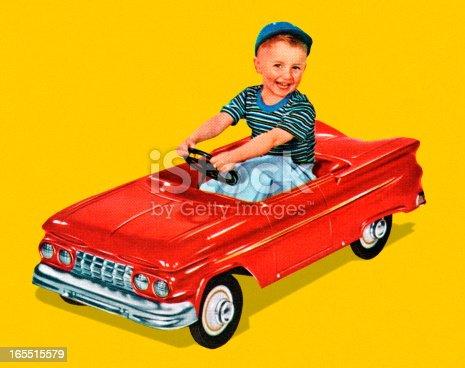 Boy Sitting in a Toy Car