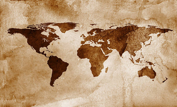 Brown world map A brown, watercolor world map on textured paper. RETROROCKET stock illustrations