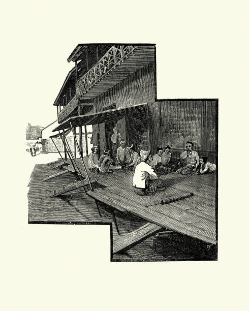 burmese family sat on porch outside their house, 19th century - burma home do stock illustrations