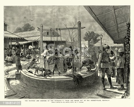 Vintage engraving of Burmese people washing themselves at a public well, Victorian, 1886, 19th Century.  A wash and brush up in the market place, Mandalay, Burma.  By F Villiers