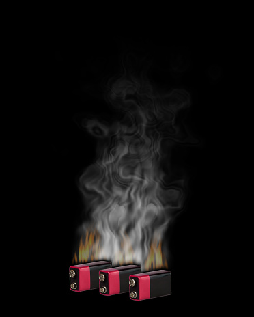 Burn and smoke the Li-ion batteries on the black background
