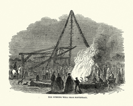 Vintage illustration of The Burning Well Near the Featherstone Station in the Vicinity of Pontefract, 1861, 19th Century.  Caused by workers boring for coal