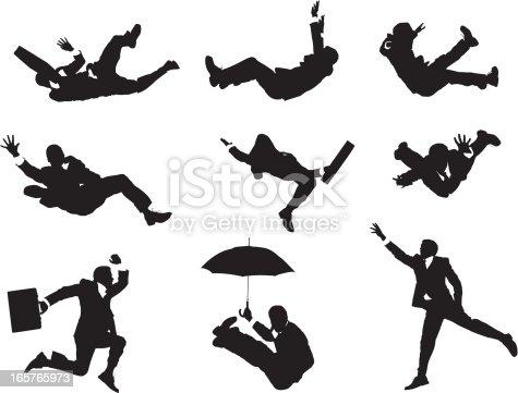 Businessmen falling through the sky