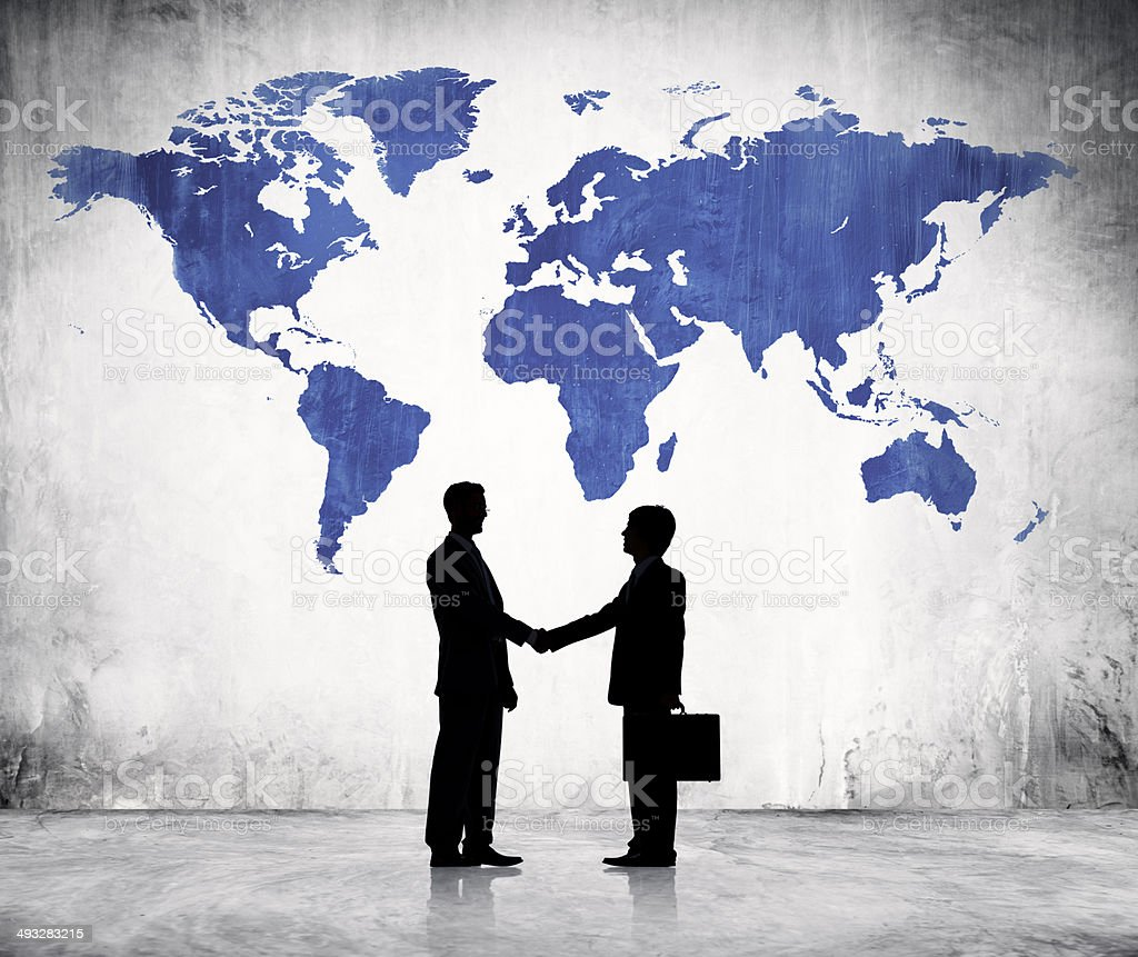 Businessmen Shaking Hands And Blue Cartography vector art illustration