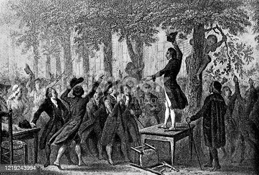 Camille Desmoulins at the Palais Royal in Paris, France on the 12th of July 1789. Vintage etching circa mid 19th century. Desmoulins leapt onto a table outside the Cafe du Foy and delivered a call to arms.