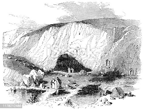 People at the Cave of Pan at Banias in Golan Heights, Israel. Vintage etching circa mid 19th century.