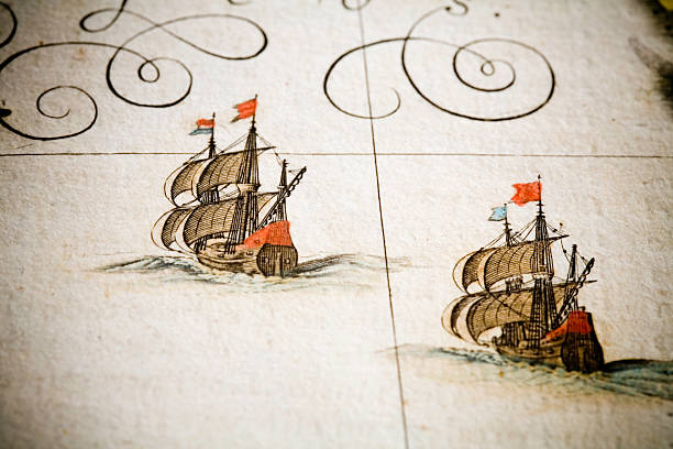 chasing ships two historical sailing ships, 17th century galleons, are sailing under full sails.am anitque spanish atlas, 18th century, hand coloured engraving. beautiful aged paper. shallow DOF.during restoration of this classic masterpiece i had the unique chance to reproduce a good part of it under perfect conditions. there are complete maps as facsimile shots and delicate details. ancient stock illustrations