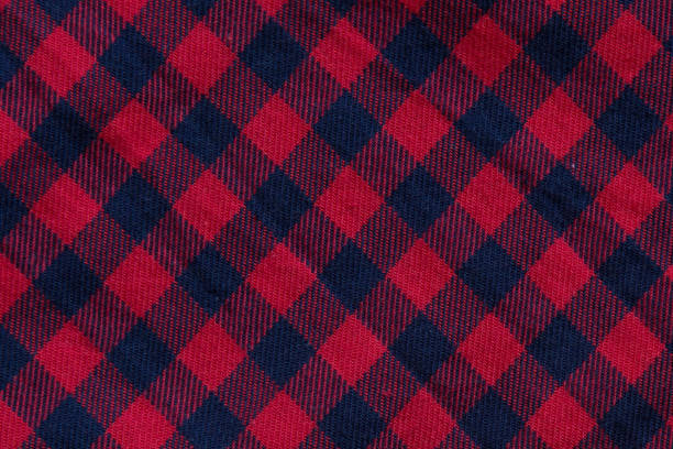 checkered cloth texture with red and blue stripes - flannel backgrounds stock illustrations, clip art, cartoons, & icons