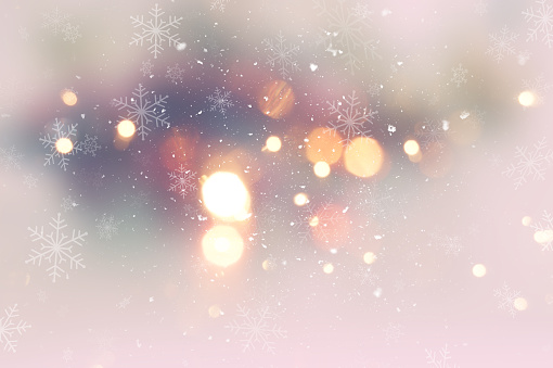 Christmas background with snow and bokeh lights
