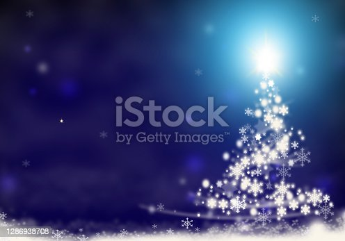 istock Christmas tree lights formed from stars background snow 1286938708