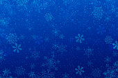 Christmas blue background with snowflakes and defocused lights