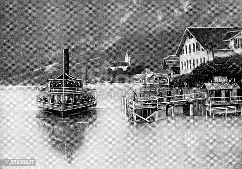 Stadt Luzern I paddle steamboat on Lake Lucerne at the town of Gersau in Schwyz Canton, Switzerland. Vintage halftone etching circa late 19th century.