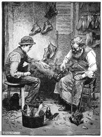 """Inside a shoe-mender's workshop, the cobbler is examining a shoe which he has either made for the customer or which needs repair. The customer is pointing to the shoe and is resting his foot on the cobbler's knee. Pieces of leather and parts of shoes are scattered around on the floor while. From """"The Juvenile Instructor: Vol XLII-Vol XII New Series"""" published by JC Watts in London, 1891."""