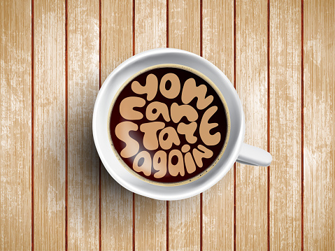 Coffee cup with time lettering you can start again on realistic wooden background. Cappuccino from above with motivation quote. Top view of espresso cup with morning motivation.