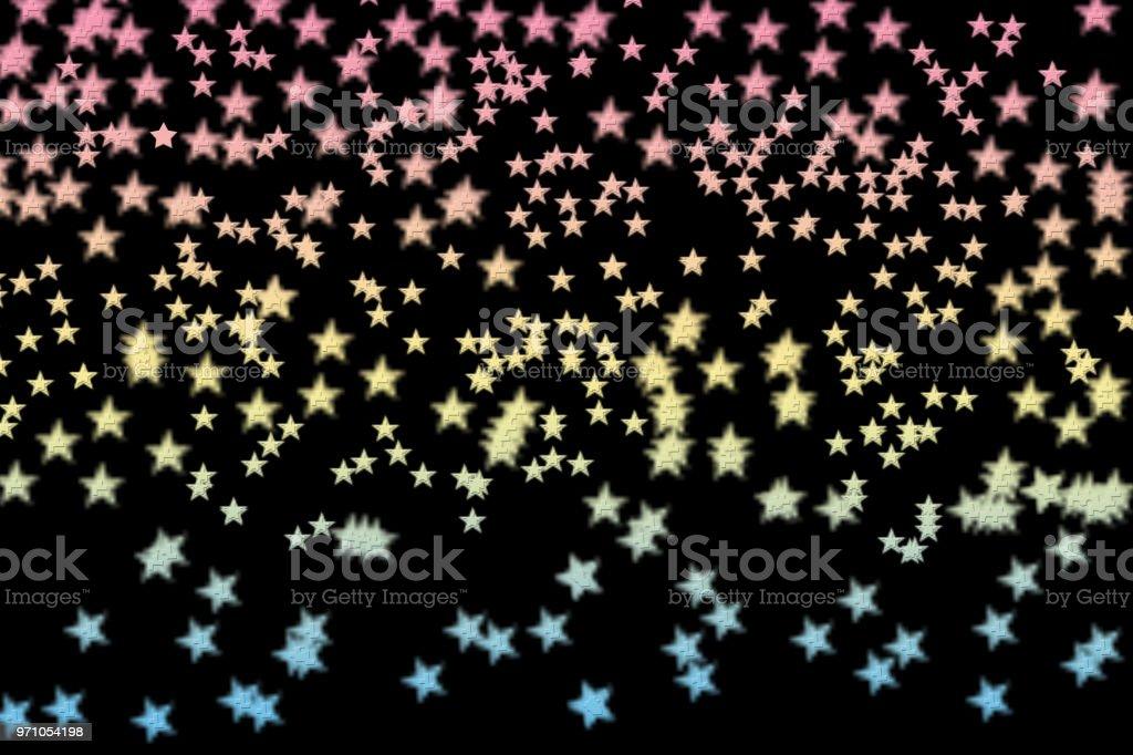 Colorful stars made n a black background. vector art illustration