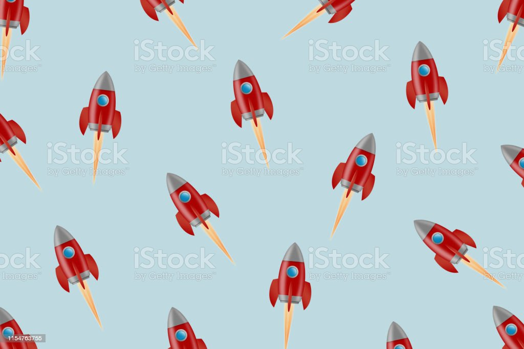 Concept Start Up. A lot of red rocket on a gray background. The...