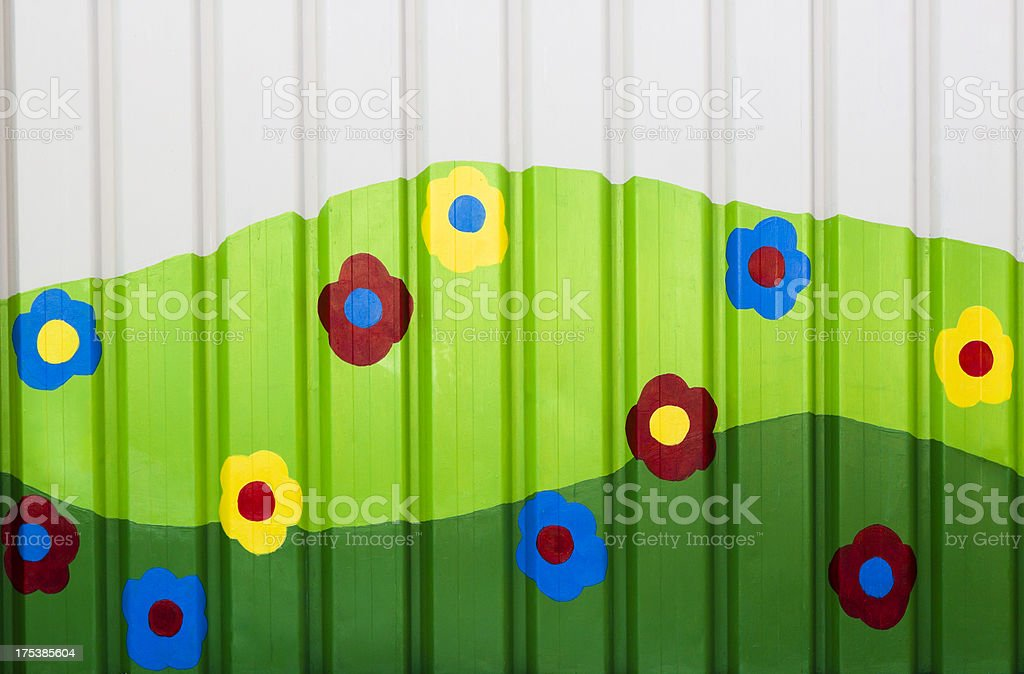 Corrugated iron with colourful flowers and green hills, copy space royalty-free stock vector art
