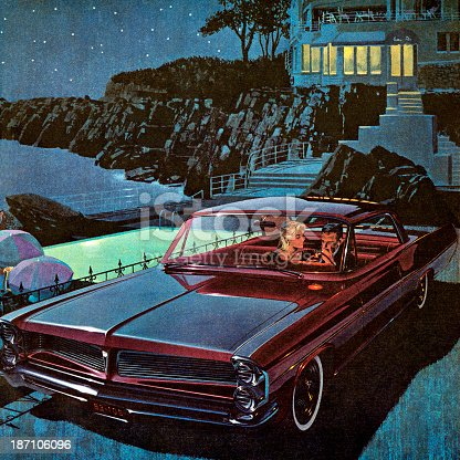 Couple in Burgandy Vintage Car at Night