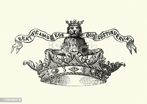 istock Crown with crowned lion holding croll in its mouth 1256085878