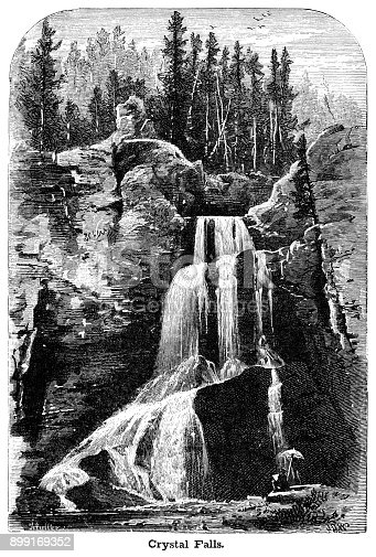 The impressive 129ft Crystal Falls in Yellowstone Park, Wyoming, with an artist at the foot making a sketch.