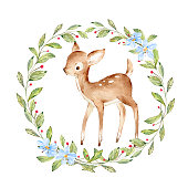istock Cute Watercolor Baby Deer surrounded by wild forest plants wreath. Full Profile Baby Deer over white. Isolated. Nursery print of Forest Animals for baby girl or boy. 1181695383