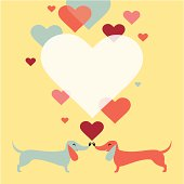 Dachshund dogs with hearts. Copy space for text.
