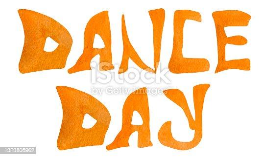 istock Dance day watercolor hand lettering orange color. 1323805962