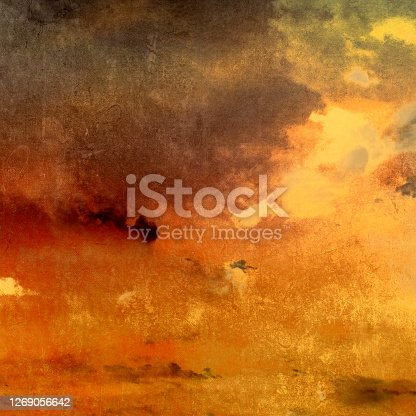 istock Dark grunge background with shiny light - abstract sunset sky with clouds and sunlight 1269056642
