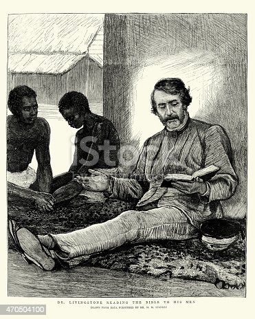 Vintage engraving of David Livingstone reading the Bible to his men. David Livingstone (19 March 1813 to 1 May 1873) was a Scottish Congregationalist pioneer medical missionary with the London Missionary Society and an explorer in Africa.  Perhaps one of the most popular national heroes of the late 19th century in Victorian Britain, Livingstone had a mythic status. The Graphic, 1874
