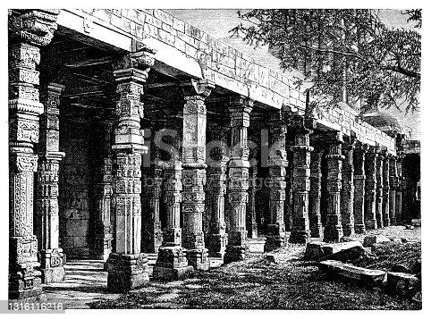 istock Delhi – Colonnade in Quitab Minar Temple, India 1316116216
