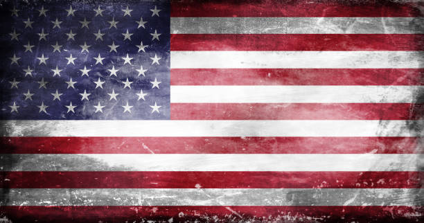 Destroyed US flag 1 US flag with traces of use in battle and destruction from difficult warfare distressed american flag stock illustrations