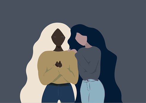 Different ethnicity girl friends long hair helping each other when one of them is crying on a grey  blue background