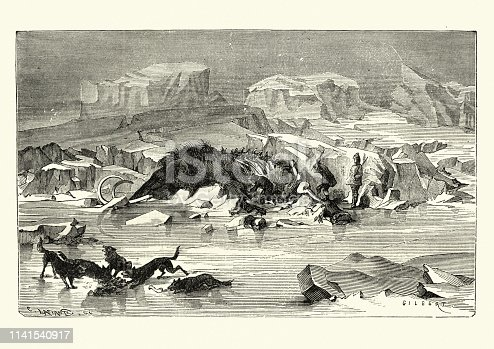 Vintage engraving of Early hunters slaughtering a wooly mammoth, with a pack of dogs, / wolves eating scraps