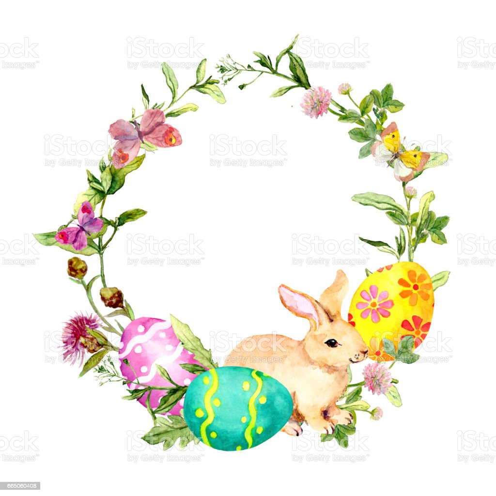 easter wreath with easter bunny colored eggs in grass and flowers
