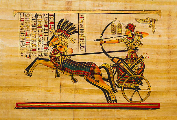 Egyptian ancient papyrus Pharaoh in the chariot. Egyptian ancient papyrus with with elements of egyptian history and religionSee more ART AND CRAFT images here: ancient egyptian culture stock illustrations
