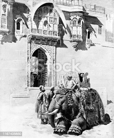 Elephant and three men at Umaid Bhagwan in Jodhpur, India during the British Raj era (circa late 19th century). Vintage etching circa late 19th century.