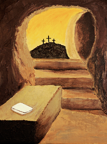 Empty tomb of Jesus with crosses and cloth
