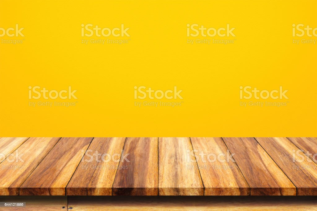 Empty top of wooden table on yellow background. vector art illustration