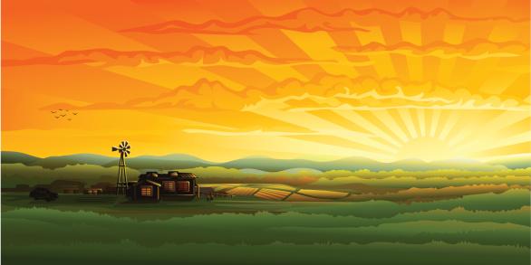 Evening countryside panorama - farm, field and wind turbine