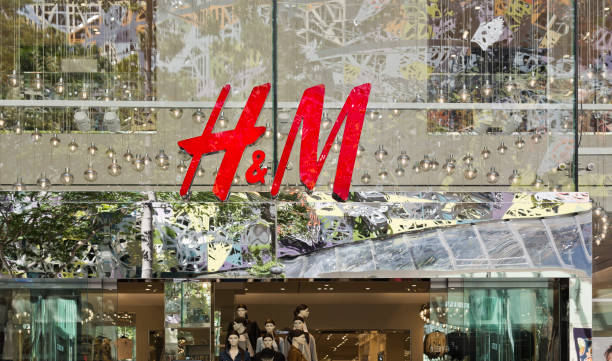 Famous Stores in Brisbane I Illustrative editorial photo of a H & M store in Brisbane central retail mall. brand name stock illustrations