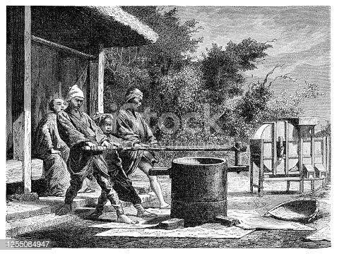 Agricultores que trabajan en la molienda de arroz Japón 1876