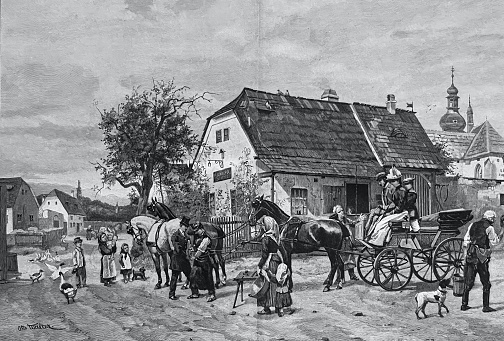 Farrier changing hooves of a horse at a carriage in the country