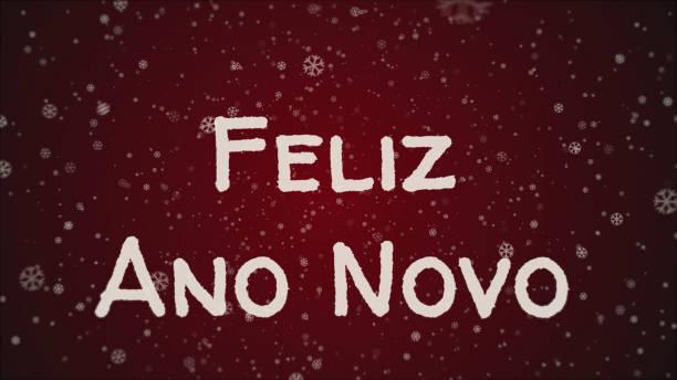 Feliz Ano Novo - Happy New Year in portuguese language, greeting card Feliz Ano Novo - Happy New Year in portuguese language, greeting card, falling snow, red background ano novo stock illustrations