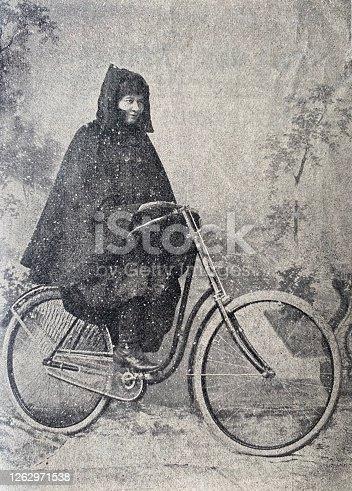 istock Female bicylist in a raincoat 1262971538