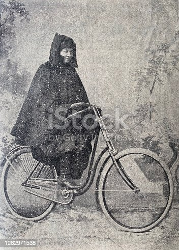istock Female bicylist in a raincoat 1262971538