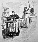 Female cutting paper for book production - 1895