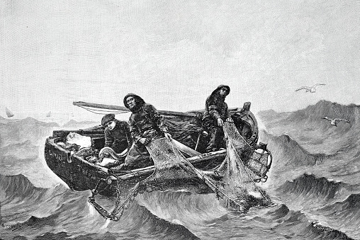 Fishermen pulling in the nets on the high seas